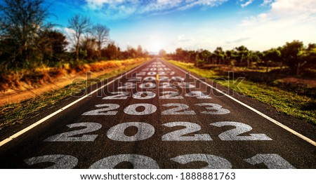 2021-2025 written on highway road in the middle of empty asphalt road and beautiful blue sky. Concept for vision 2021-2025.