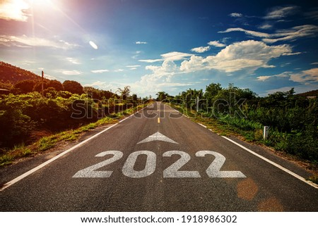 2022 written on highway road with arrow in the middle of empty asphalt road and beautiful blue sky. Concept for vision 2021-2022.