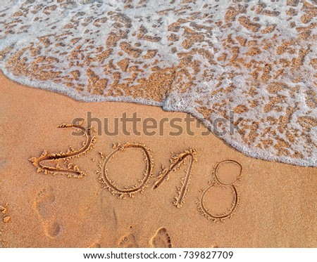 2018 written on sandy beach New Year is coming  like date holiday concept #739827709
