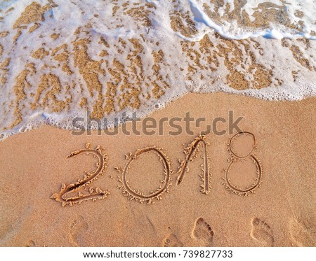 2018 written on sandy beach New Year is coming  like date holiday concept #739827733