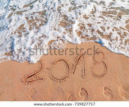 2018 written on sandy beach New Year is coming  like date holiday concept #739827757