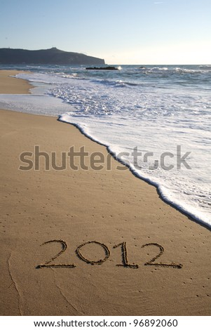 2012 written on the beach vertical in south of italy