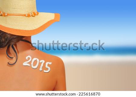 2015 written on woman's back #225616870