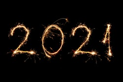 2021 written with Sparkle firework on black background, happy new year 2021 concept.