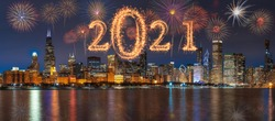 2021 written with Sparkle firework with multicolor of fireworks on Panorama scene of Chicago cityscape river side along Lake Michigan background, USA skyline,Happy new year and merry Christmas concept