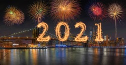 2021 written with Sparkle firework with multicolor of fireworks on Panorama scene of New York cityscape with Brooklyn Bridge background, USA downtown skyline,Happy new year and merry Christmas concept