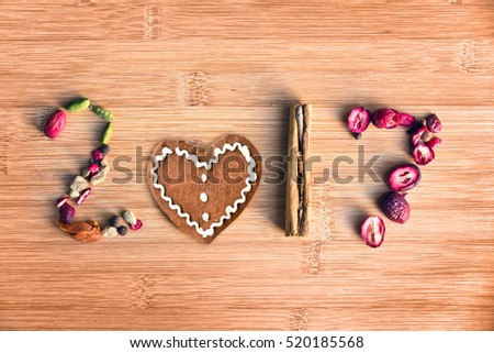 2017 written with spices on wooden background, food 2017 new year concept #520185568