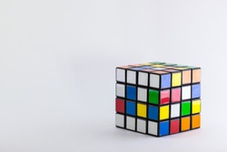 4x4 cube unsolved and scrambled on a plain white background