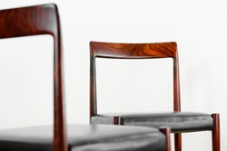 2x danish rosewood CHAIR Danish Design Chairs Mid Century 60s Vintage Dining leather seat wood Modern antique 50s 70s retro original isolated on white wall in modern living room closeup loft