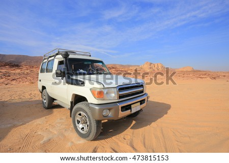4x4 Jeep Toyota Land Cruiser. Off road car in the desert in Egypt #473815153
