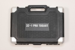 32 x 1 professional car repair tool box placed flat lay on a gray background