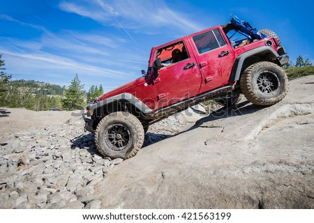 4x4 truck descending steep rock on the Rubicon Trail near Lake Tahoe, CA.