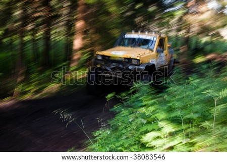 4x4 truck driving trough mudy track in blury motion