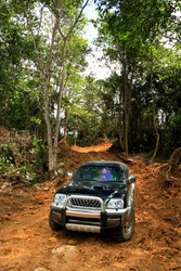 4x4 vehicle driving offroads in a difficult dirt terrain