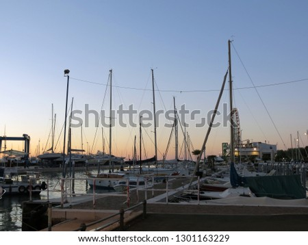 Yachts and fishing boats at the pier in the evening,Rimini,Italy.