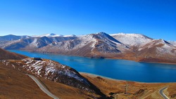 Yamdrok Lake is a freshwater lake in Tibet, it is one of the three largest sacred lakes in Tibet. It is over 72 km long. The lake is surrounded by many snow mountain.