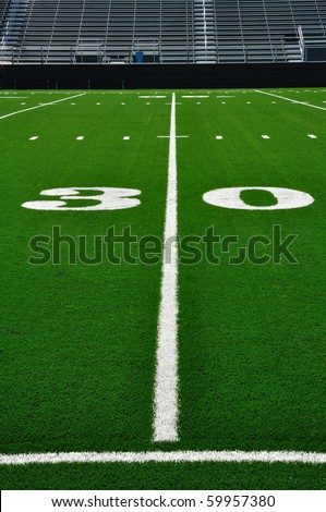 30 Yard Line on American Football Field with Bleachers