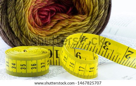 Yarn colored and yellow centimeter tape