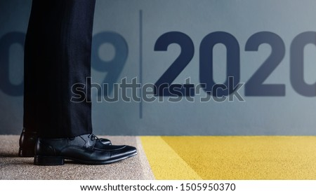 2020 Year Concept. Low Section of Businessman on Formal Business Dress Get Ready to Moving Forward from 2019 to New Year Challenge. Cropped Image. Side View