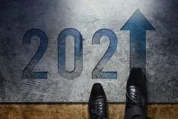 2021 Year Concept. Top View of Businessman on Formal Business Shoes standing on the Floor to Steps into Number and Forward Arrow