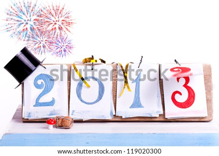 2013 year desk calendar with happy new year decoration, switching from year 2012 to year 2013, Happy New Year celebration background