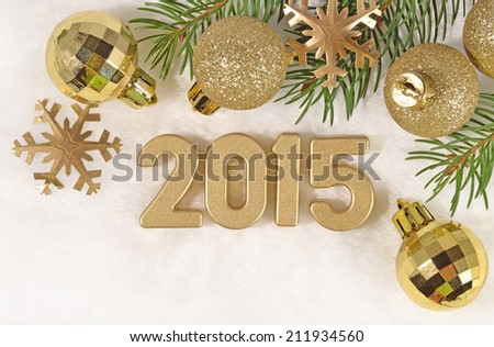 2015 year golden figures and a spruce branch #211934560