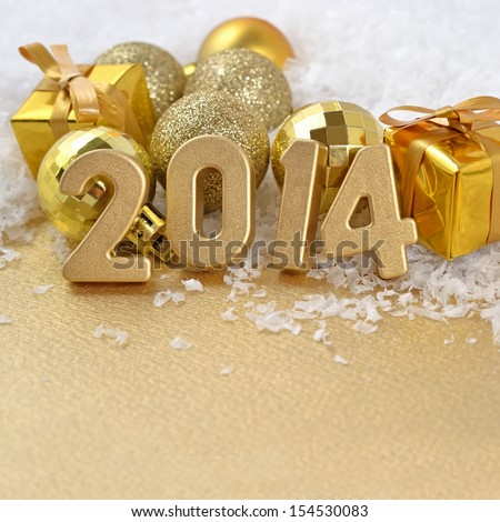 2014 year golden figures on the background of golden C��hristmas balls