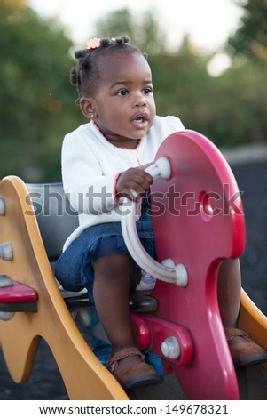 3-year old African American Girl Playing in the Playground