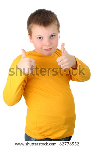 10 year old boy showing thumbs up gesture isolated on white - stock