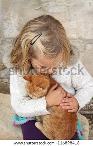 5 year old girl holding a cat