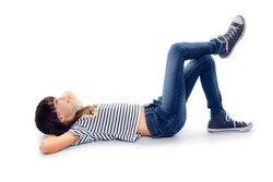 10 year old girl look up while lie on ground with legs crossed