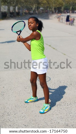 13 year old girl playing tennis