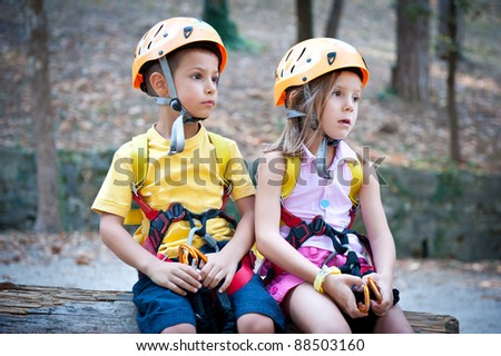 6 year old Kids with climbing equipment.
