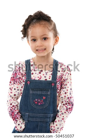 5 year old little girl standing smiling isolated on white background