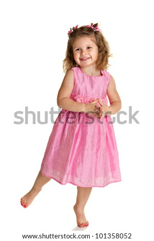 3 year old little girl with pink dress dance pose happy portrait on white background - stock photo