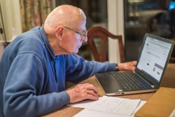 93 year old man having trouble using his computer to check his finances online,very challenging for old people.