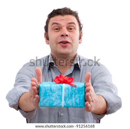 40 year old man holding a gift box, isolated on white background