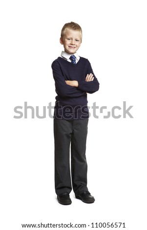 8 year old school boy arms folded on white background