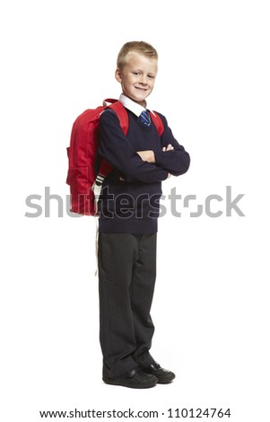 8 year old school boy arms folded with backpack on white background