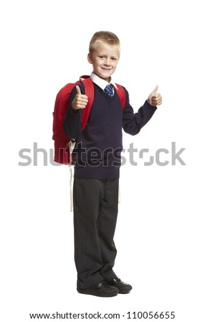 8 year old school boy with thumbs up and backpack on white background
