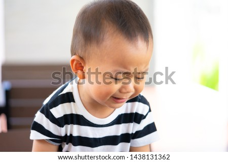 2.5 year old toddler asian boy crying and uncontrollable and bad behavior and show problem face at home.Attention deficit hyperactivity disorder (ADHD) Concept.