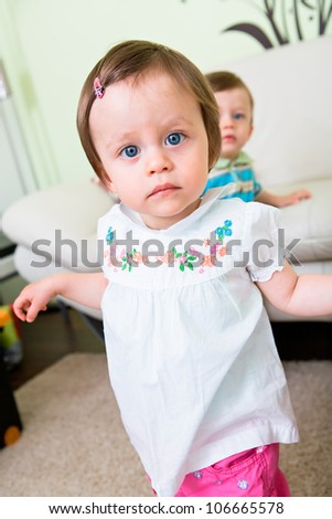 stock photo : 1 year old twins in the flat