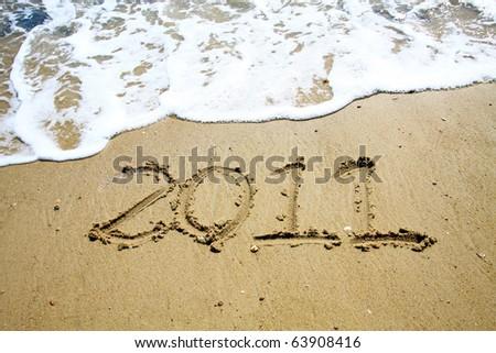 2011 year on sand - stock photo