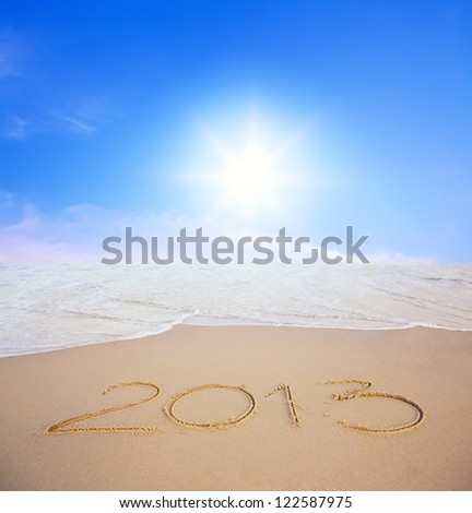 2013 year on the beach with blue sky and sun