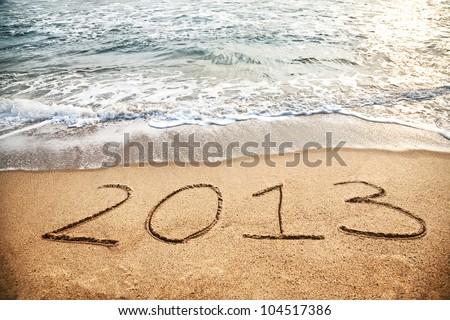2013 year on the sand beach near the ocean
