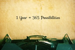 1 Year = 365 Possibilities: Inspiration Motivational Quotes on Vintage Paper Background.