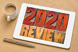 2020 year review banner - annual review or summary of the recent year - word abstract in letterpress wood type blocks on a digital tablet with a cup of coffee