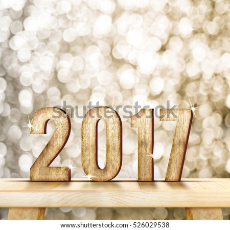 2017 year wood number on wood table with gold sparkling bokeh wall and wooden plank floor,leave space for adding your content #526029538