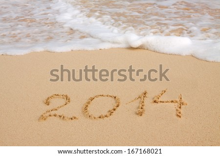 Year 2014 written in sand on tropical beach  #167168021