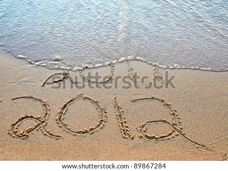 2012 year written on beach for New year's eve